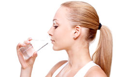 Água bebendo da mulher bonita Imagens de Stock