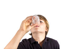 Água bebendo do menino fora de um vidro Fotos de Stock Royalty Free