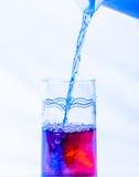 Água colorida em um vidro Fotos de Stock