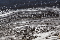 Água com testes padrões de Swirly foto de stock royalty free