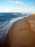 Água contra a areia foto de stock royalty free