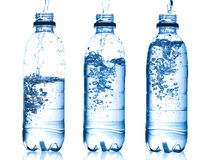 Água de derramamento no frasco Imagem de Stock Royalty Free