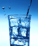 Água de derramamento no vidro Imagem de Stock Royalty Free