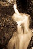 Água de pressa Imagens de Stock