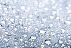 A água deixa cair o fundo Imagens de Stock Royalty Free