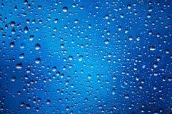 A água deixa cair o fundo abstrato Fotografia de Stock