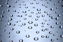 A água do aço inoxidável deixa cair o fundo imagem de stock royalty free