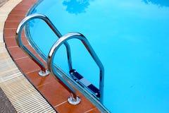 Água e guarda-chuvas Fotos de Stock Royalty Free