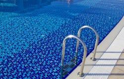 Água e guarda-chuvas Imagens de Stock