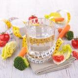 Água e vegetal dietético Fotografia de Stock Royalty Free