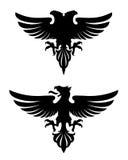 Águia heráldica má escura Imagem de Stock