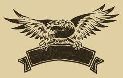 Águila con la cinta Imagen de archivo libre de regalías