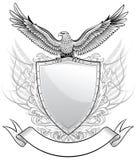 Águila sobre el blindaje Imágenes de archivo libres de regalías