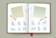 Álbum abierto con los marcos de la foto y las siluetas en blanco de los gatos Fotos de archivo libres de regalías