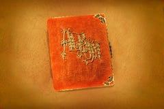 Álbum de foto anaranjado antiguo Fotos de archivo