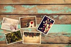 Álbum de fotografias do xmas do Feliz Natal na tabela de madeira velha fotografia de stock royalty free