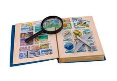 Álbum de los sellos, de los aviones y de la lupa de la aviación Fotografía de archivo libre de regalías
