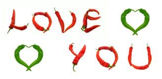 ÁMELE texto y dos corazones integrados por las pimientas de chile Foto de archivo libre de regalías