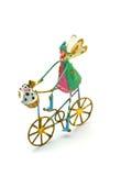 Ángel aislado de la Navidad en una bicicleta con el perro Imagen de archivo