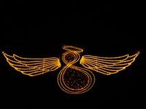 Ángel con las alas hechas de luces en fondo negro imágenes de archivo libres de regalías