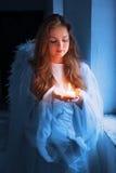 Ángel con una vela Fotos de archivo