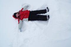 Ángel de la nieve del invierno Imágenes de archivo libres de regalías