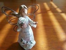 Ángel del amor de madres Imagenes de archivo