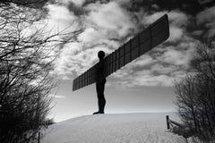Ángel del metal en invierno Fotos de archivo