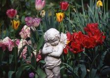 Ángel en los tulipanes Foto de archivo libre de regalías