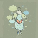 Ángel en una nube con el corazón Imágenes de archivo libres de regalías