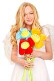 Ángel rubio con las flores divertidas Foto de archivo libre de regalías