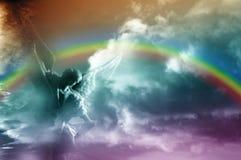 Ángel y arco iris fotos de archivo