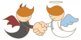 Ángel y diablo que sacuden la mano Imagen de archivo