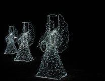 Ángeles de la Navidad en un fondo negro Fondo Imagen de archivo