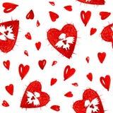 Ángeles rojos del amor con el modelo inconsútil del corazón Foto de archivo