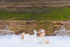 Ángeles y estrellas en nieve Fotos de archivo libres de regalías