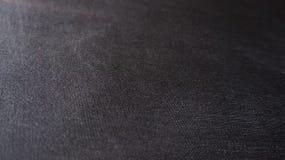 Ángulo plano del primer del detalle de la textura de la tela compuesta negra del paño Imágenes de archivo libres de regalías
