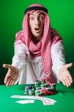 Árabe que juega en casino Imagen de archivo libre de regalías