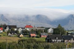 Árbæjarsafn in Reykjavík on a beautiful day with a fog in the mountain of Esja. Old and beautiful houses from the 18th and 19th centuries stock image