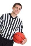 Árbitro adolescente con baloncesto Imagen de archivo libre de regalías