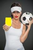 Árbitro de la mujer con la tarjeta amarilla Imágenes de archivo libres de regalías