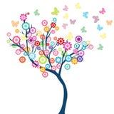 Árbol con las flores y las mariposas Imagen de archivo libre de regalías
