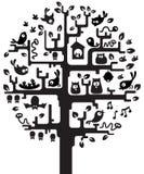 Árbol con los habitantes Imagenes de archivo