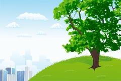 Árbol con panorama de la ciudad Fotografía de archivo