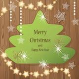 Árbol de navidad con la guirnalda luminosa y en el backgroun de madera stock de ilustración