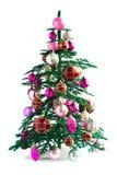 Árbol de navidad con los juguetes brillantes en blanco Foto de archivo libre de regalías