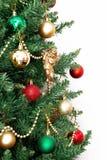 Árbol de navidad con los juguetes y un ángel de oro aislados en los vagos blancos Imagenes de archivo