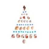Árbol de navidad de cáscaras Días de fiesta en el mar Imagen de archivo libre de regalías