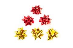 árbol de navidad de los arqueamientos del oro y del rojo Imágenes de archivo libres de regalías