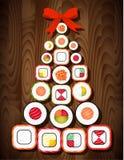 Árbol de navidad del rollo de sushi con el arco rojo en fondo de madera de la tabla Imagen de archivo libre de regalías